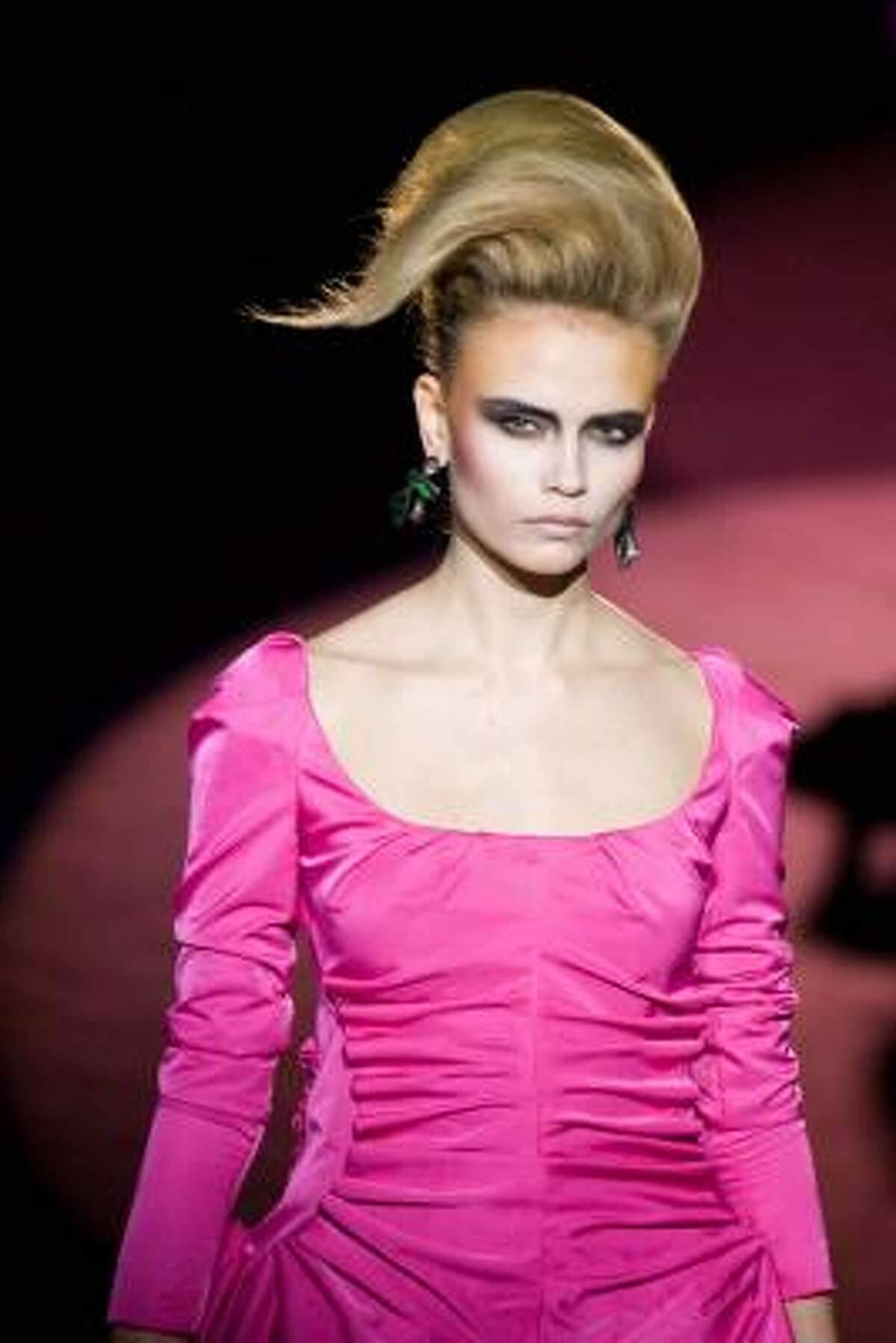 Model Natasha Poly makes a statemen in this hot pink Marc Jacobs Fall 2009 ruched dress. Read more about how to incorporate the color into your wardrobe at Hot pink is popping.