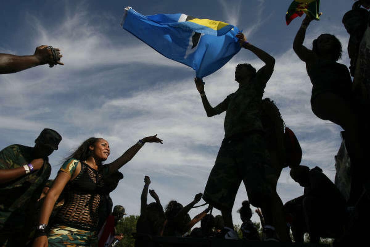 Lennel Alexander waves the flag of St. Lucia.