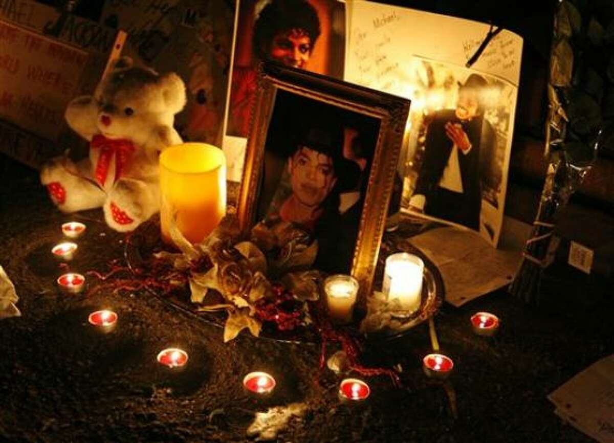 Candles light a makeshift memorial for Michael Jackson outside the Jackson family home in the Encino area of Los Angeles on Tuesday, July 7, 2009.