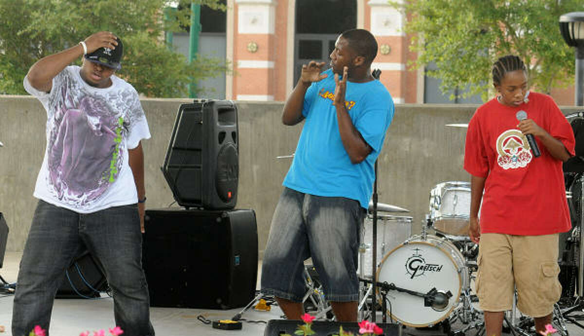 Brian Presley, Marcus Hannibal and K Ross perform during the fest.
