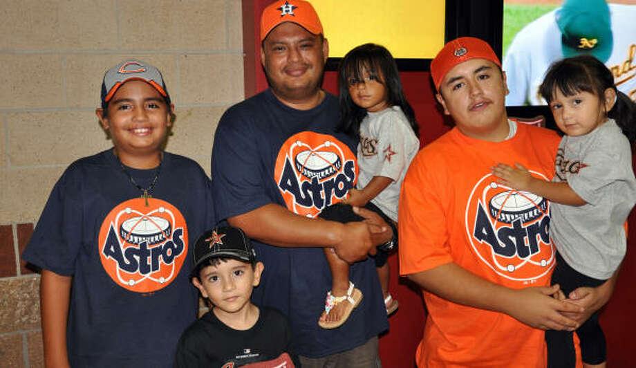 The Cantu and Macias families show their Astros pride. Photo: Chris Elliott, For The Chronicle