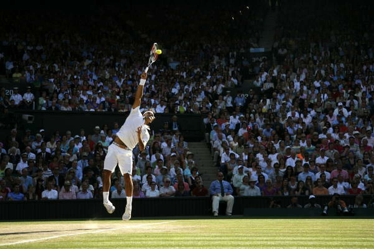 Switzerland's Roger Federer serves a ball to Andy Roddick of the U.S. in the Wimbledon final. Federer won 5-7, 7-6, 7-6, 6-3, 16-14.