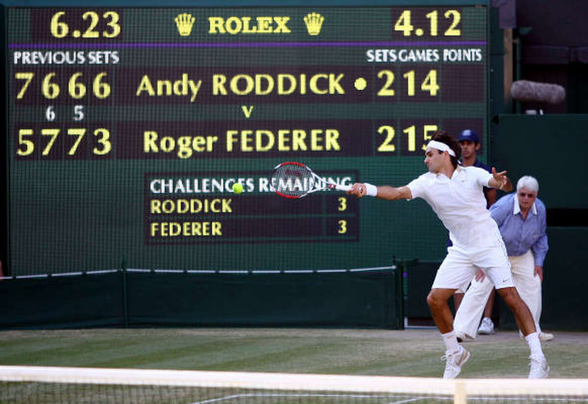 Roger Federer plays a forehand during the men's singles final against Andy Roddick.