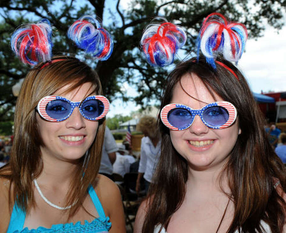Jennifer Sanchez and Mary Veedell, both 15, show off their Fourth of July festive spirit at League Park, where League City threw a party as part of Citizen Appreciation Day. Photo: Kim Christensen, For The Chronicle