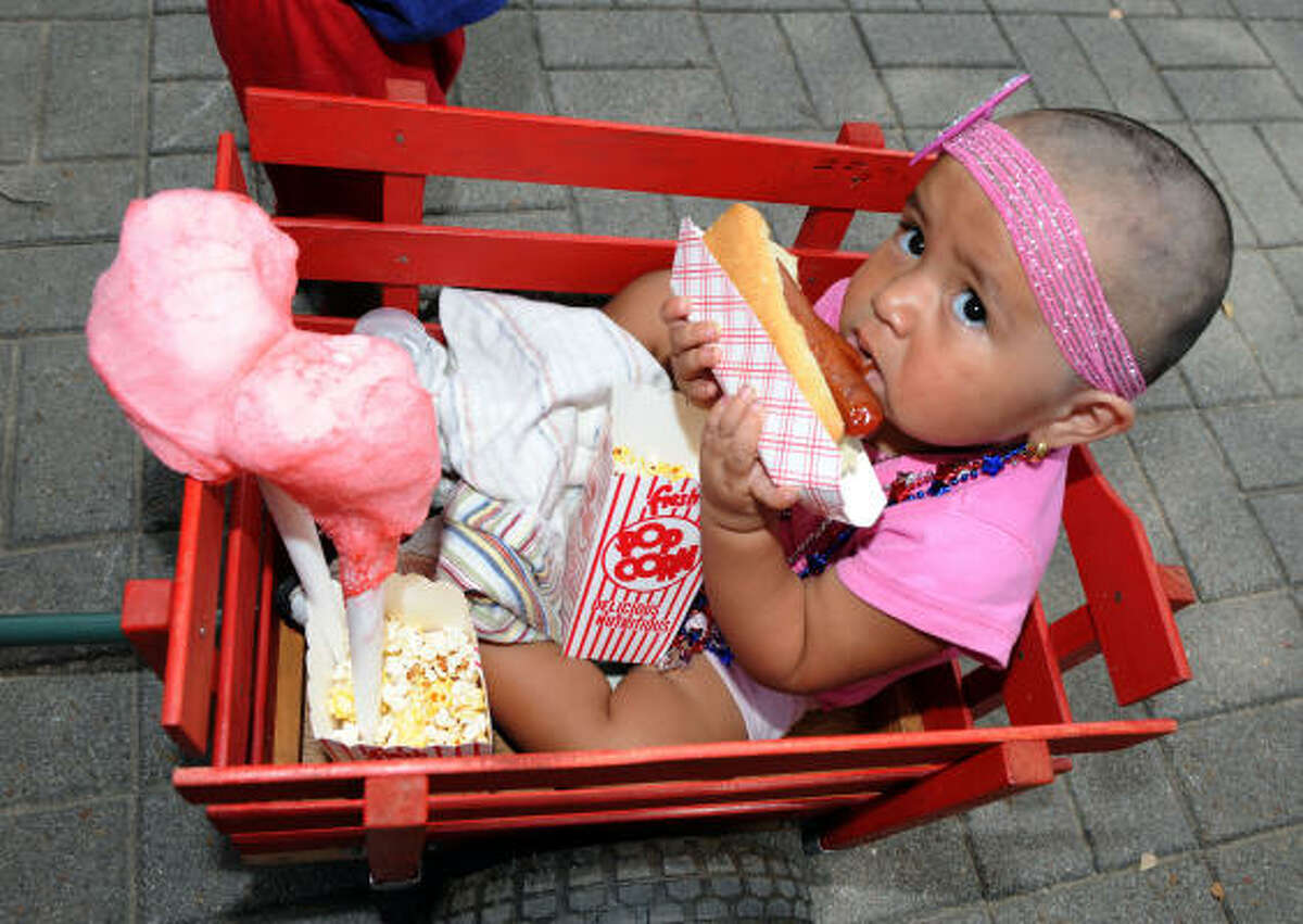 Leslie Valencia, 2, tackles a hot dog.