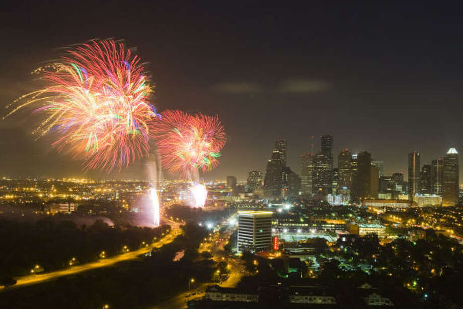 Fireworks light up the Houston skyline during the Freedom Over Texas bash. Photo: Smiley N. Pool, Chronicle