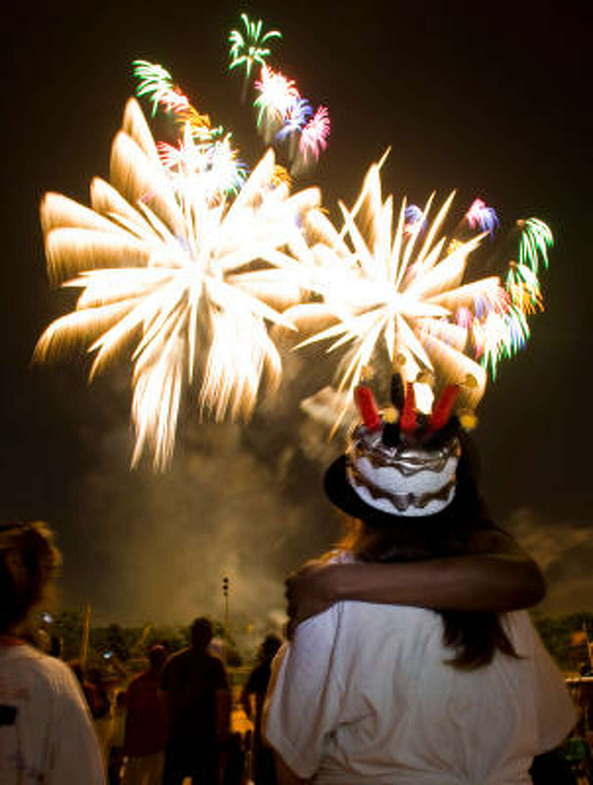 Crowds enjoy the fiery show at Freedom over Texas at Eleanor Tinsley Park.