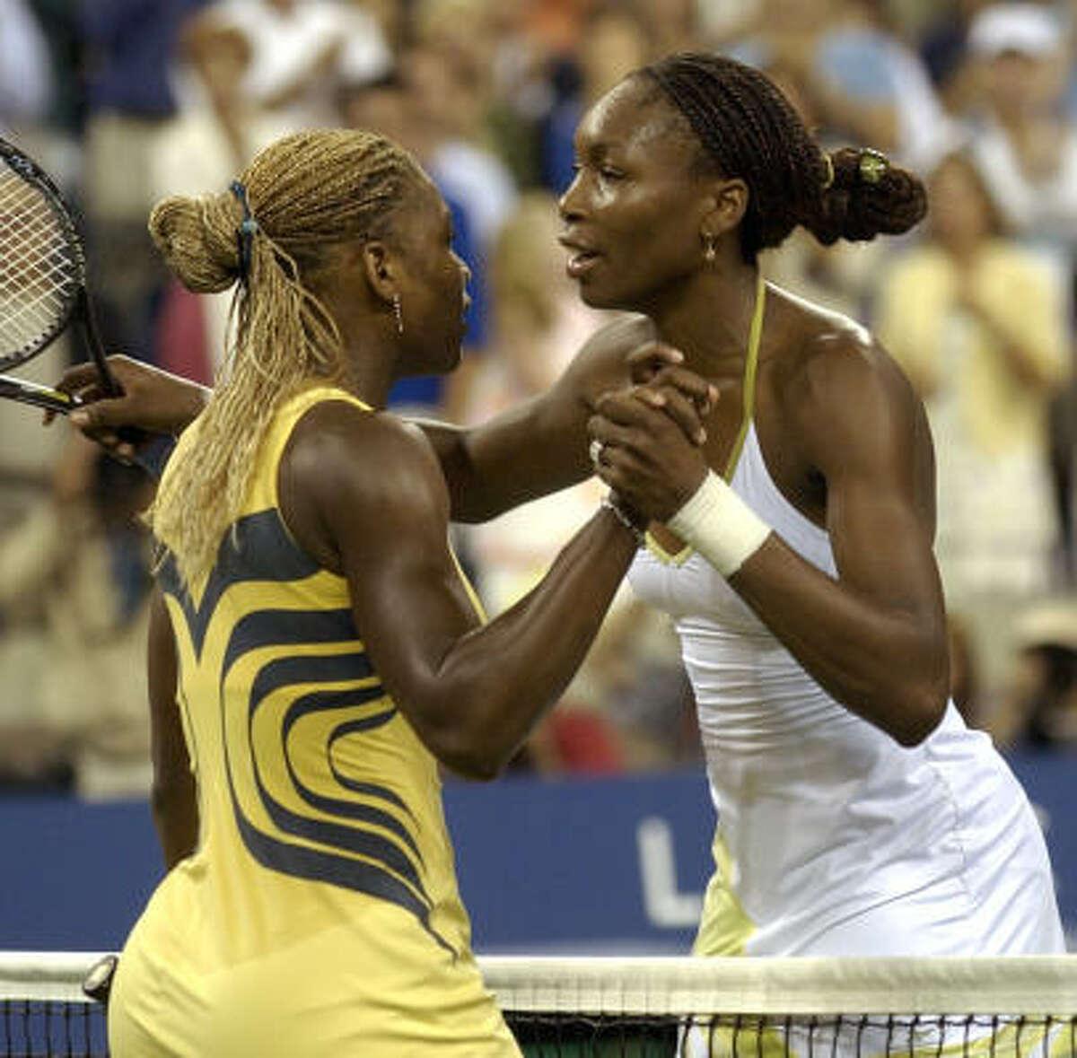 U.S. Open - Sept. 8, 2001: Serena, left, greets her sister after Venus won 6-2, 6-4. Advantage: Venus, 2-0.