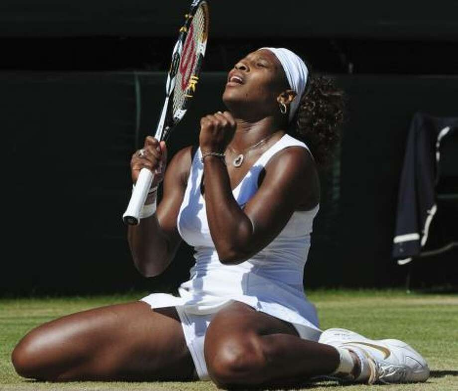 Serena Williams celebrates match point against sister Venus. Serena won 7-6 (3), 6-2 for her third Wimbledon title and 11th Grand Slam championship. Photo: Peter Van Den Berg, AP