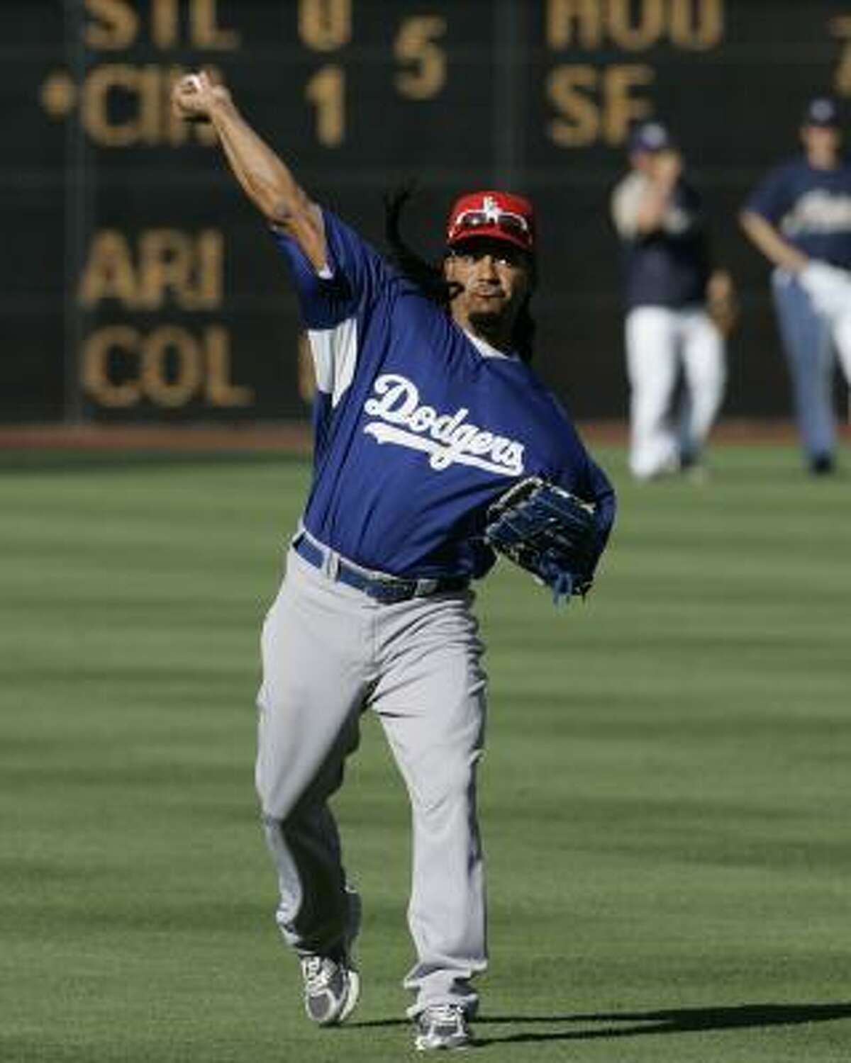 Dodgers left fielder Manny Ramirez warms up for his first Major League game after serving a 50-game suspension.