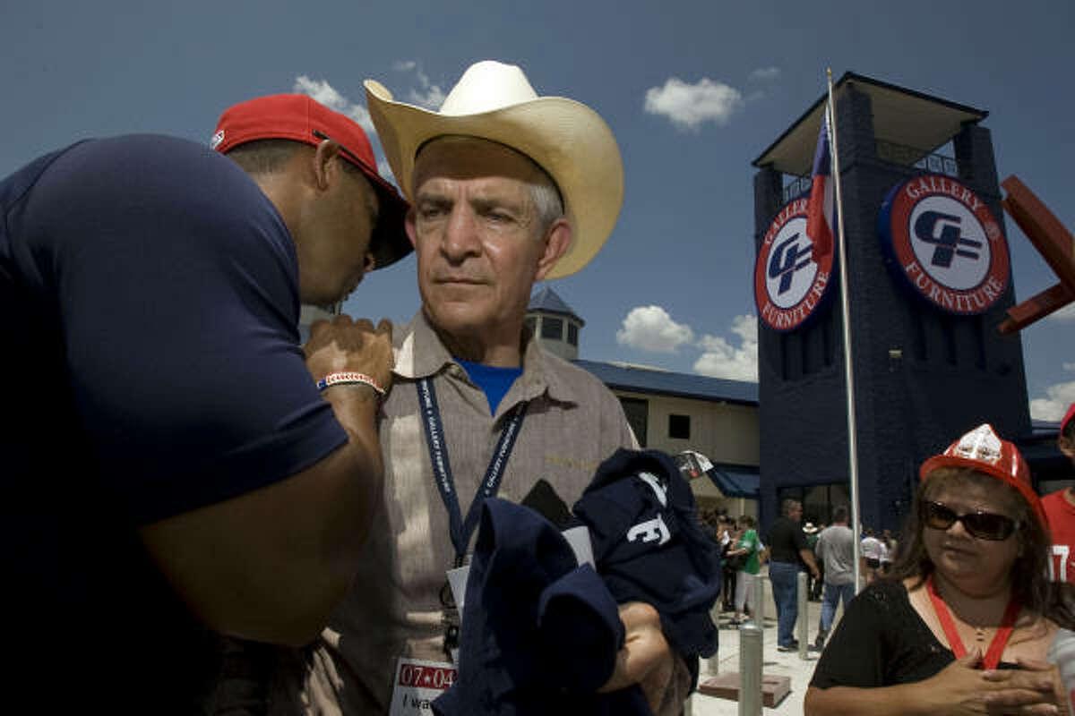 Firefighter Rucker greets McIngvale, telling him