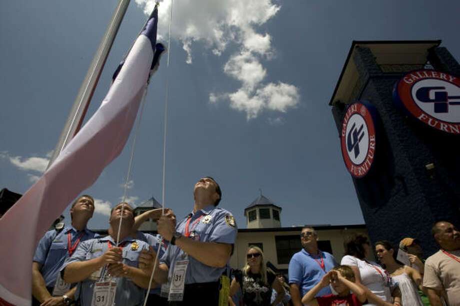 A group of Houston firefighters help raise a Texas state flag at the celebration. Photo: Johnny Hanson, Chronicle