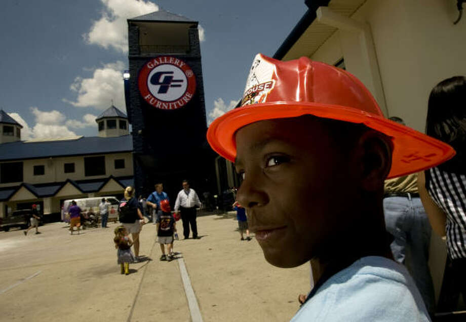Richard Polk, 8, whose uncle works for the Fire Department,  attended the celebration. Photo: Johnny Hanson, Chronicle