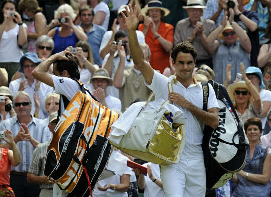 Roger Federer beat Tommy Haas 7-6 (3), 7-5, 6-3 and will face Andy Roddick in Sunday's final. A victory would give Federer his 15th Grand Slam singles championship, breaking a tie with Pete Sampras for the most in history Photo: ADRIAN DENNIS, AFP/Getty Images