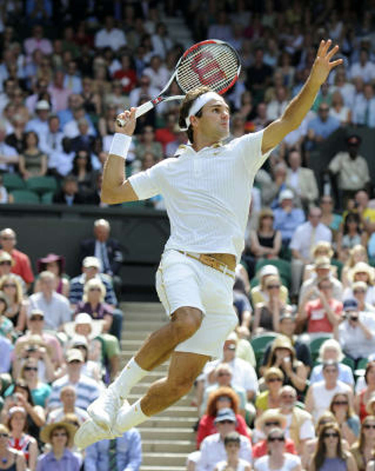 Switzerland's Roger Federer won 72 of 83 points on his serve, did not face a single break point and finished with 49 winners and only 15 unforced errors against Tommy Haas.