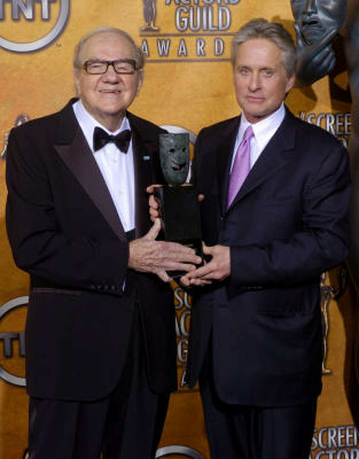 In this Feb. 22, 2004 photo, Karl Malden, left, displays his Life Achievement Award with presenter Michael Douglas at the 10th annual Screen Actors Guild awards in Los Angeles.