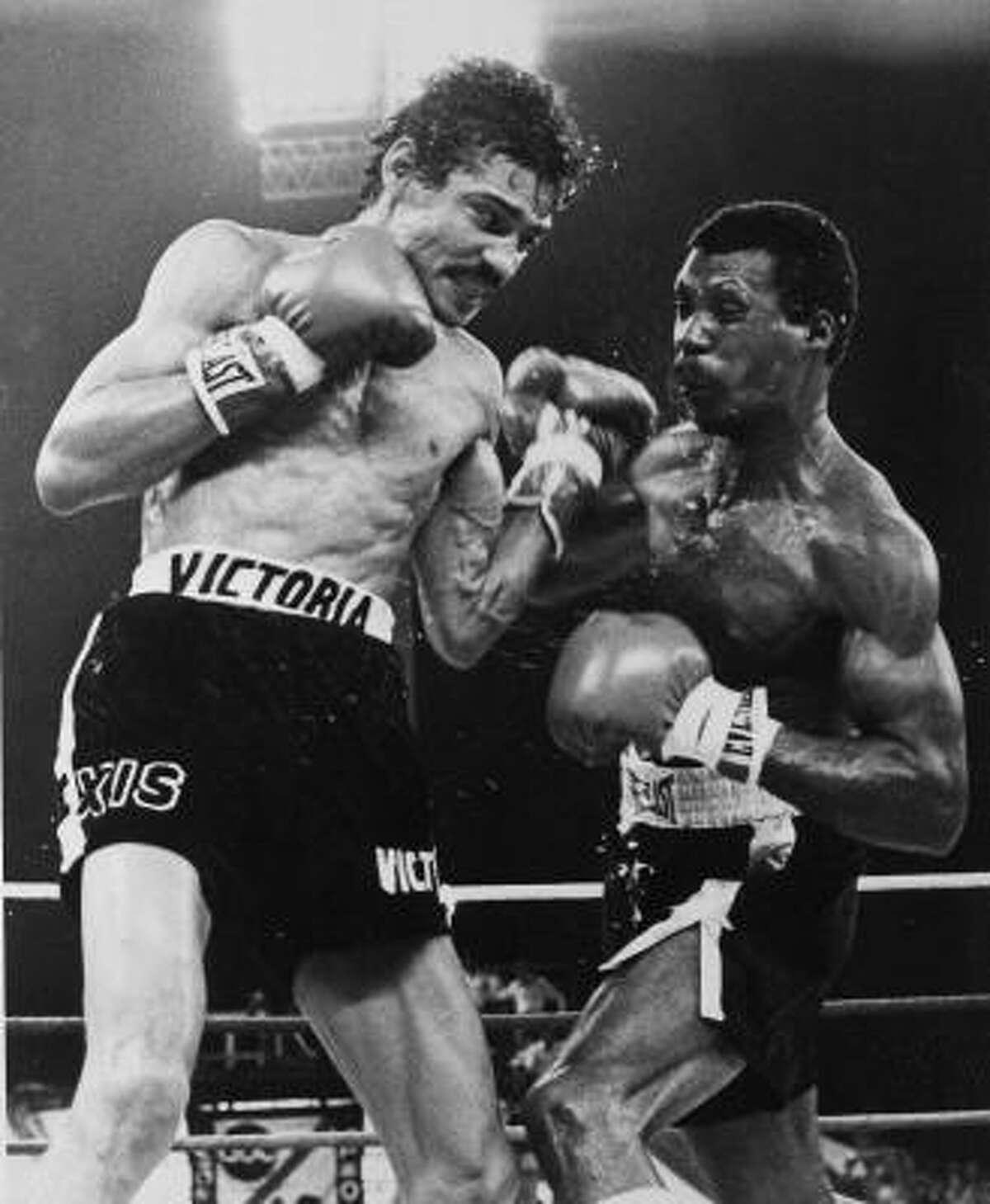 Alexis Argüello, left, battles Puerto Rico's Alfredo Escalera on Jan. 28, 1978, in the ninth round of their WBC title fight near San Juan. Argüello won against the tough Escalera by 13th-round TKO.