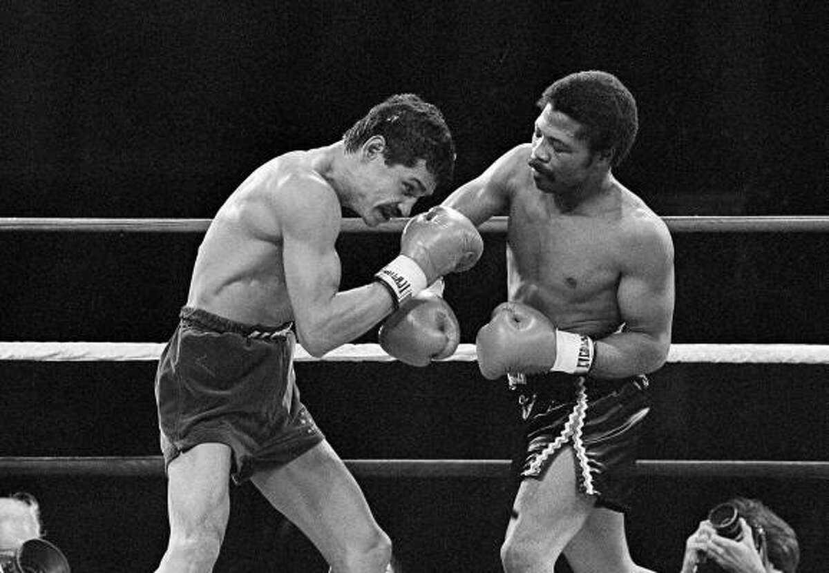 Alexis Argüello covers up as undefeated WBA World light welterweight champ Aaron Pryor throws a hard right during the second round of their epic bout at the Orange Bowl in Miami. Pryor won with a brutal 14th-round TKO in a fight named best of the decade. It was perhaps, the greatest fight ever. See video of the fight.