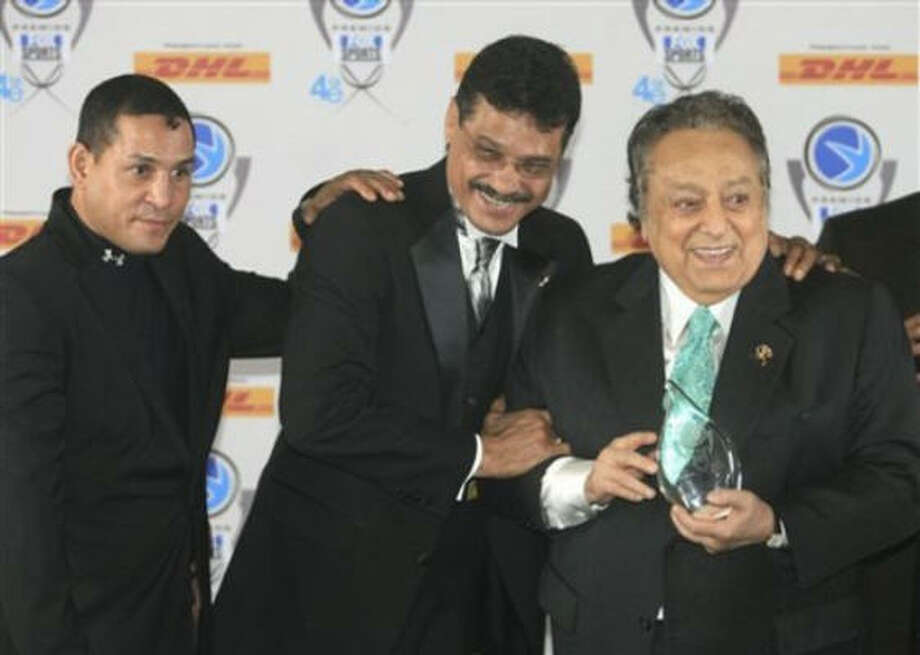 Hector Camacho, left, and late boxing legend Alexis Arguello, center congratulate boxing executive Jose Sulaiman, right, of Mexico, for his Outstanding Career award at the Premios Fox Sports Awards at the Jackie Gleason Theater in Miami Beach, Fla., on Dec. 14, 2006. Photo: Luis M. Alvarez, AP Photo