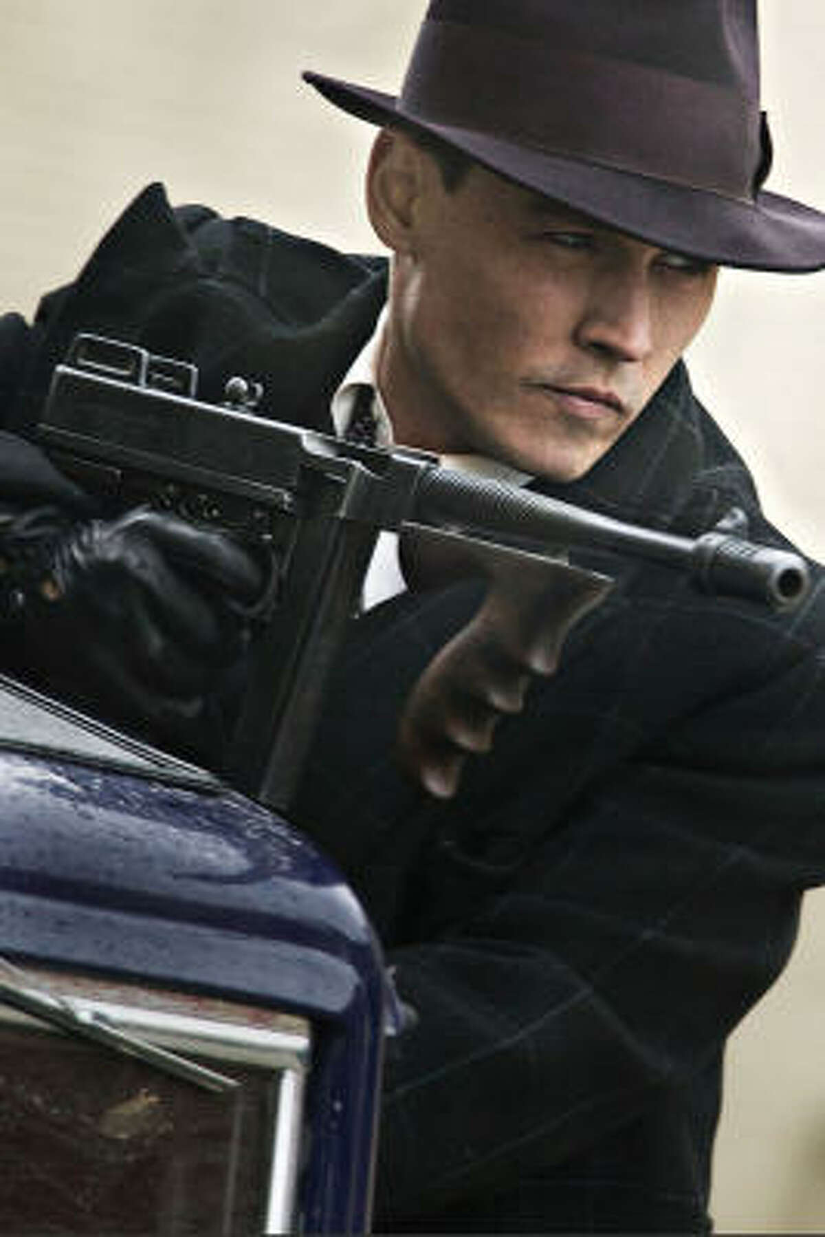 Johnny Depp stars as legendary Depression-era outlaw John Dillinger in the new film by Michael Mann, Public Enemies. To read the review of Public Enemy click here.