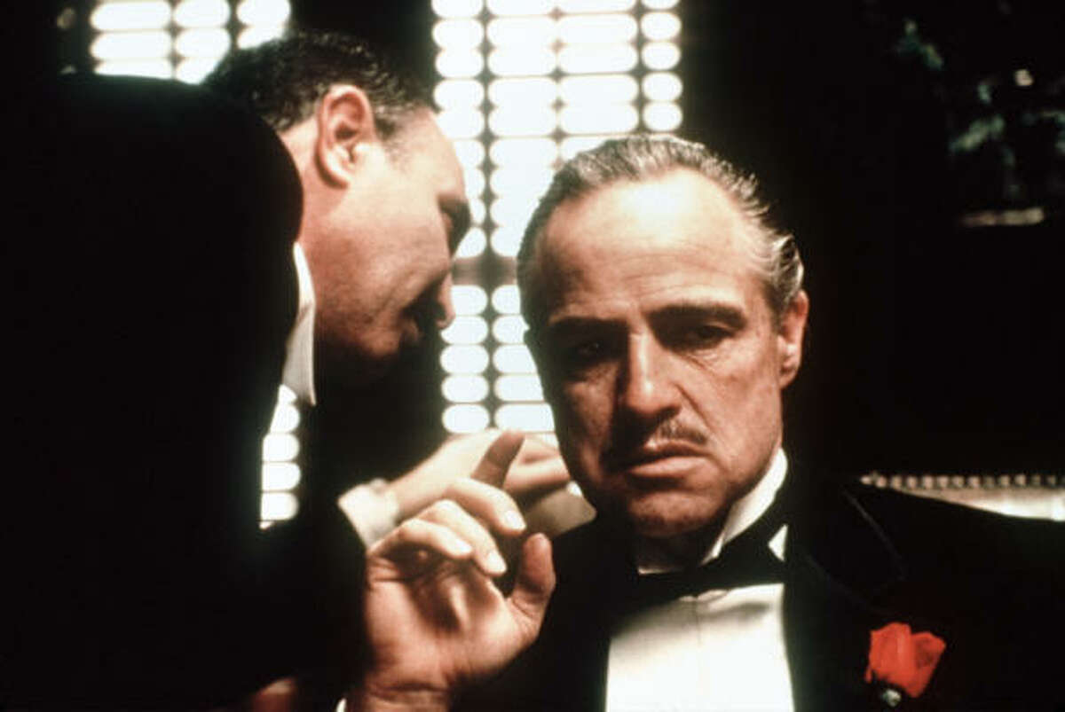 Vito Corleone (Marlon Brando, The Godfather): Brando gets the nod over De Niro's portrayal of the title character because of the older version's dark mystery and the already arrived quality of the kindly patriarch, who also made people wet their pants in fear. The improvised orange-in-the-mouth ape scene alone, in the greater context of the head of the Corleone crime family, is enough for enshrinement here.