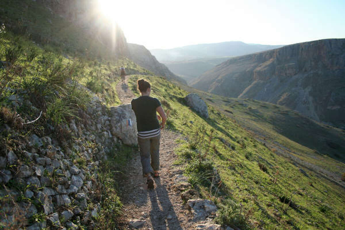 The Jesus Trail, which is designed to begin in Nazareth, Israel, leads hikers along the Arbel cliffs.
