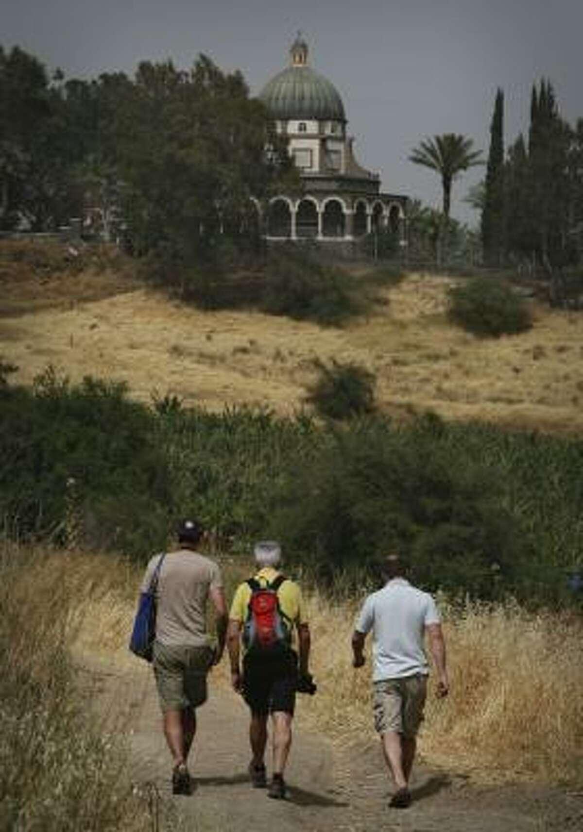 Austrian hikers climb the Jesus Trail toward a church on the Mount of Beatitudes.