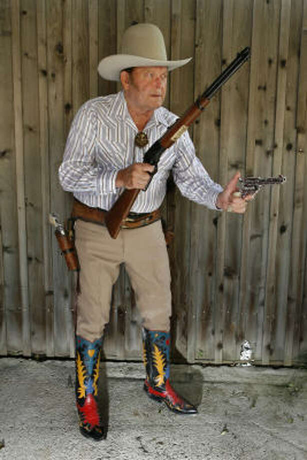 Joe Bowman, an internationally know Wild West marksman, performed in Wild West touring shows here and in Europe. Photo: Carlos Antonio Rios, Houston Chronicle