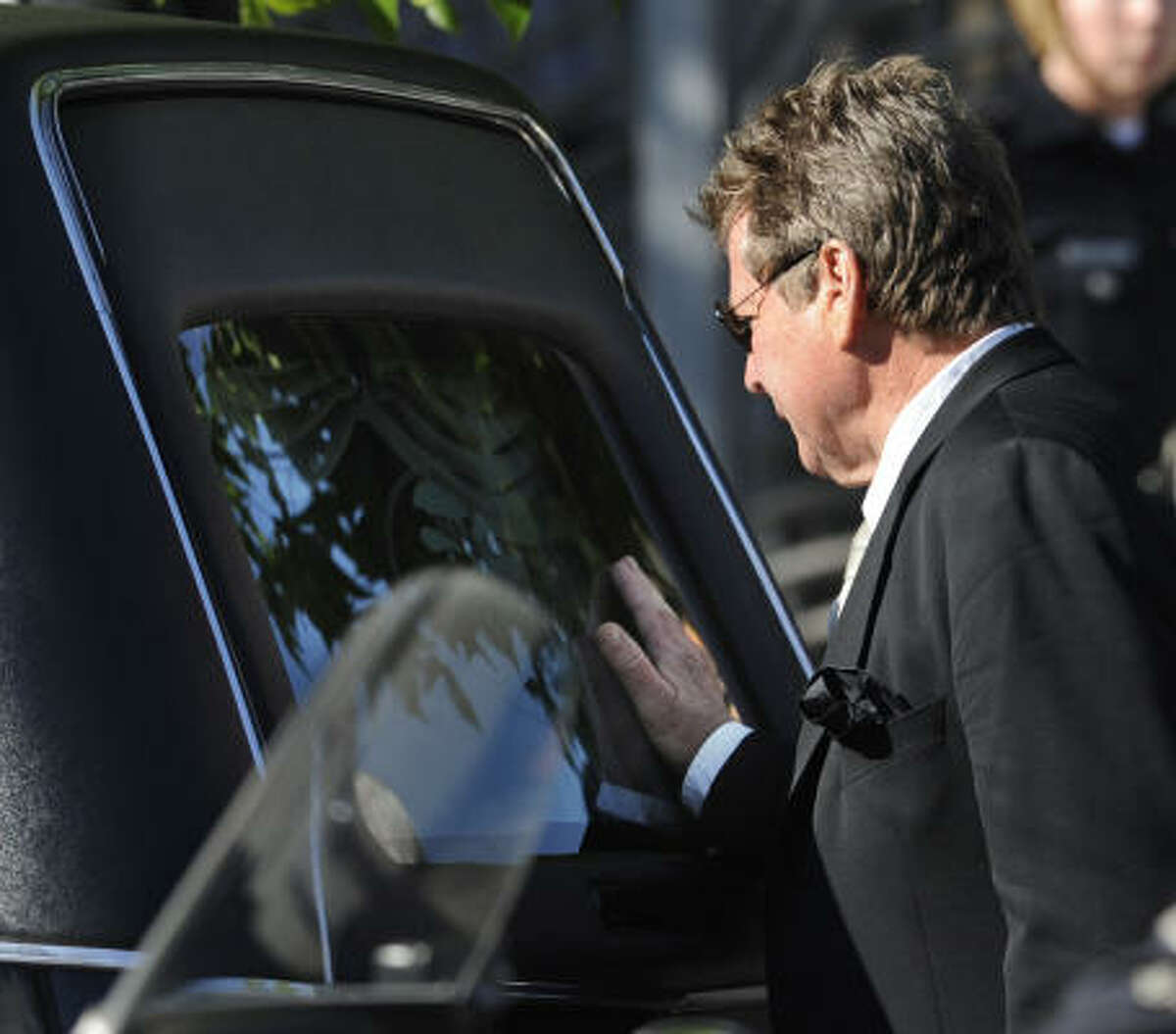 O'Neal touches the back of the hearse carrying Fawcett's casket after her funeral service.