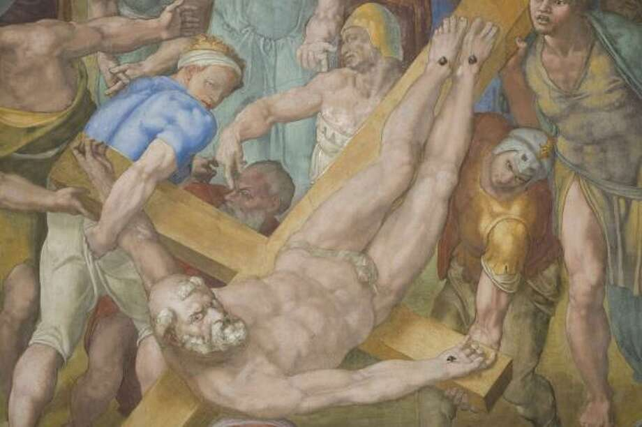 Detail of Michelangelo's Crucifixion of St. Peter is seen after the restoration of the fresco. Photo: AP