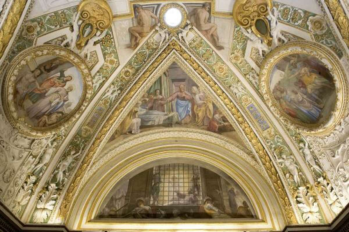 The ceiling painted by Michelangelo.