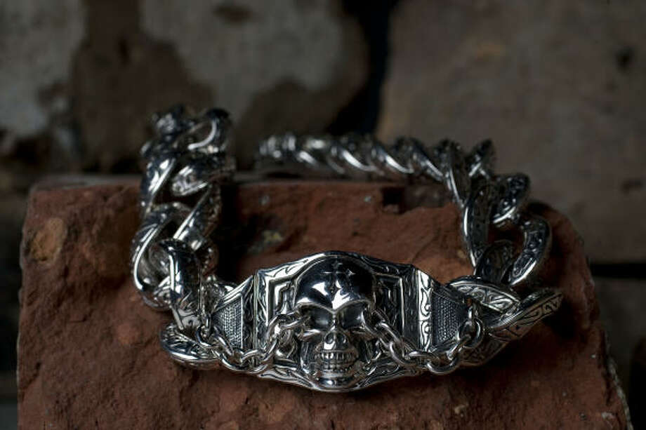 Scott Kay fancy curb link skull bracelet, $1,075, Donoho's Jewelry. Meet the designer at the store on July 17 before the Aerosmith-ZZ Top concert at The Woodlands Pavilion -- and you might also rub elbows with some of his most famous fans. Photo: Johnny Hanson, Houston Chronicle