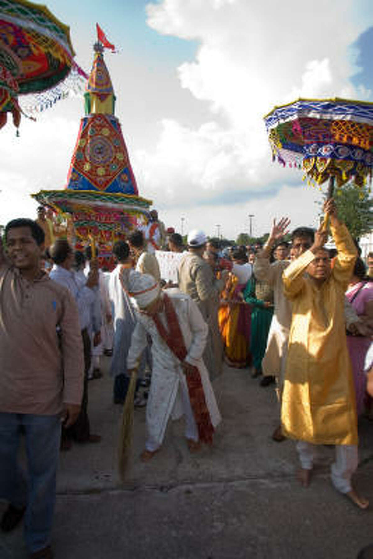 Harish Randwani, playing the Raja of Puri, sweeps the path of the chariot. This part of the ceremony symbolizes the subjugation of earthly authority to that of the Divine.