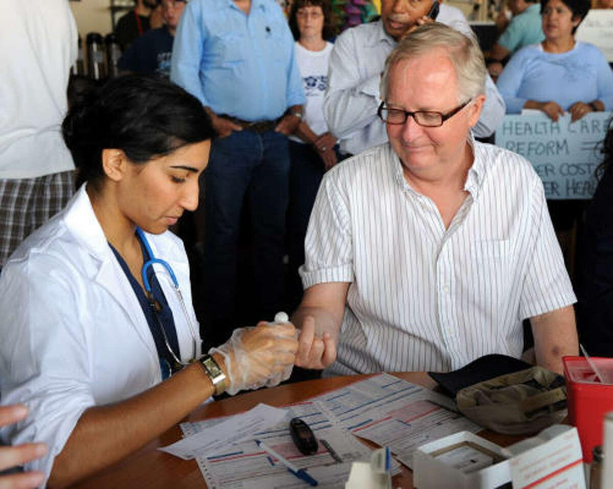 Colin Fox has his blood checked by Yasra Imtiaz.