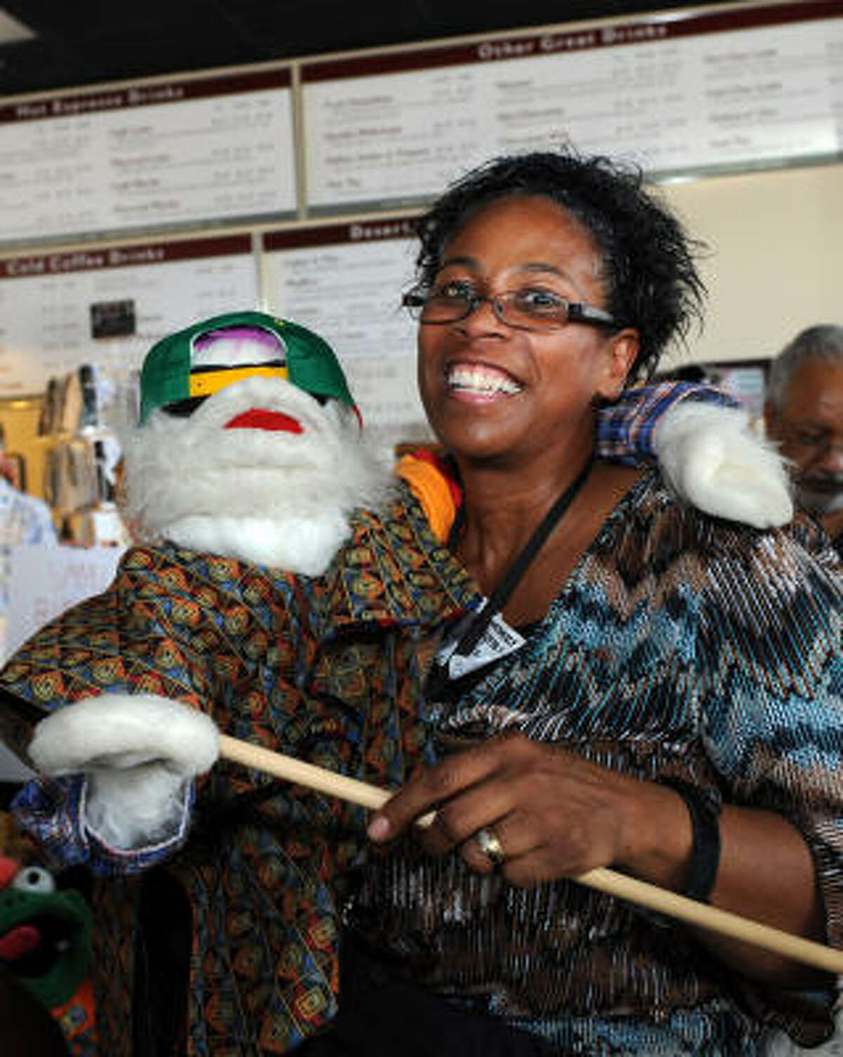 Verda Gaines shows off her puppet Mack at the health fair.
