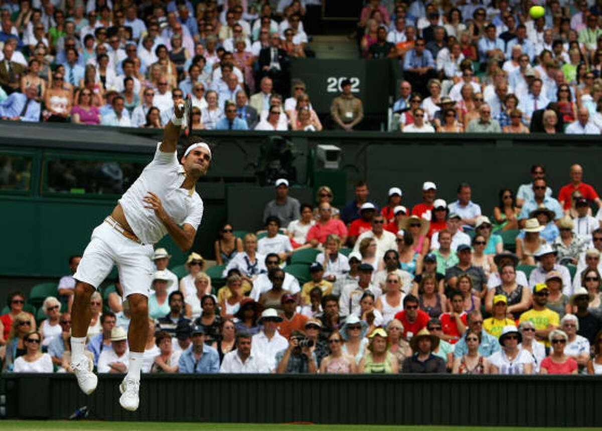 Second-ranked Roger Federer of Switzerland serves during his fourth-round win over Robin Soderling of Sweden, 6-4, 7-6, 7-6.