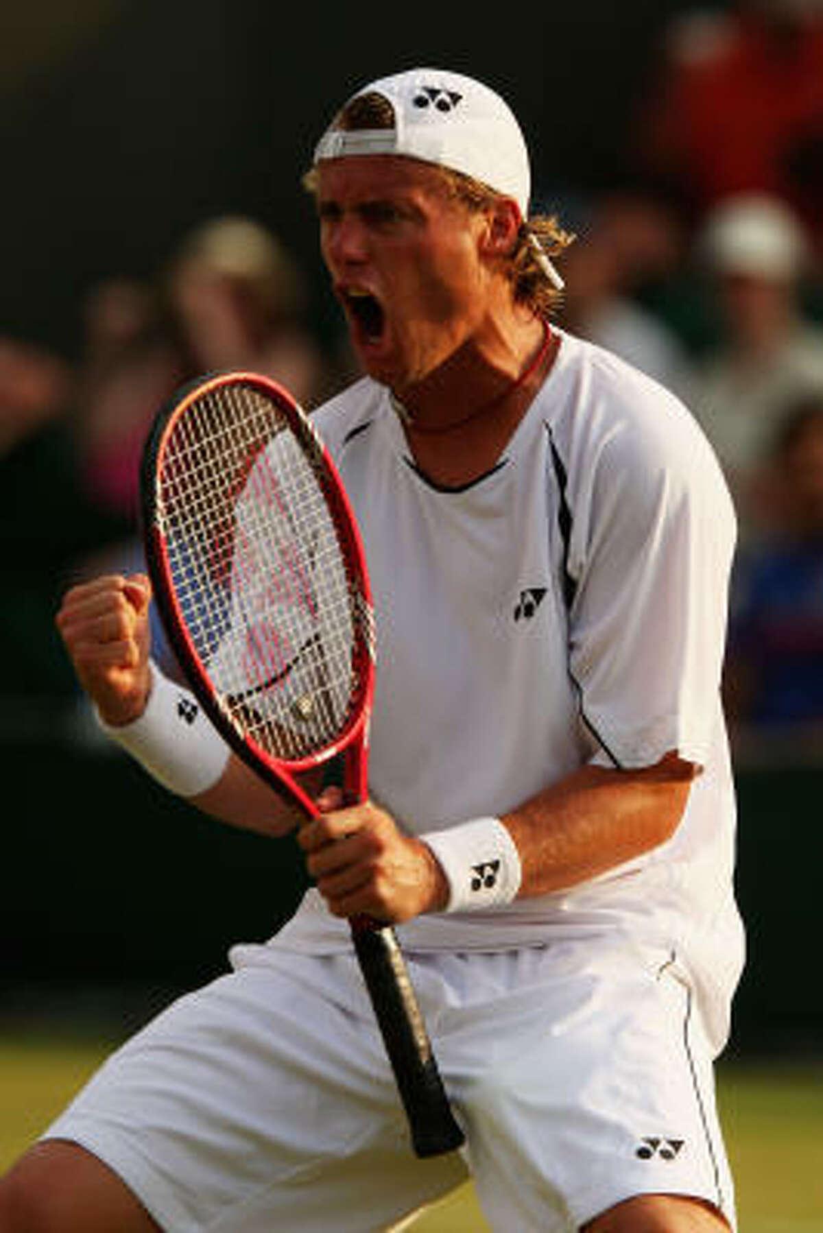 Australia's Lleyton Hewitt celebrates during his fourth-round victory over Radek Stepanek of Czech Republic. Hewitt beat 23rd-ranked Stepanek 4-6, 2-6, 6-1, 6-2, 6-2.