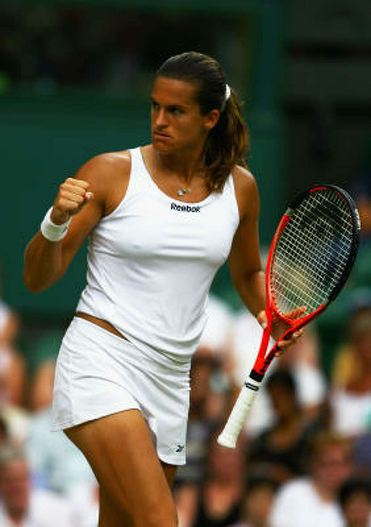 France's Amelie Mauresmo celebrates during her fourth-round match against Dinara Safina of Russia. Safina won the match 4-6, 6-3, 6-4.