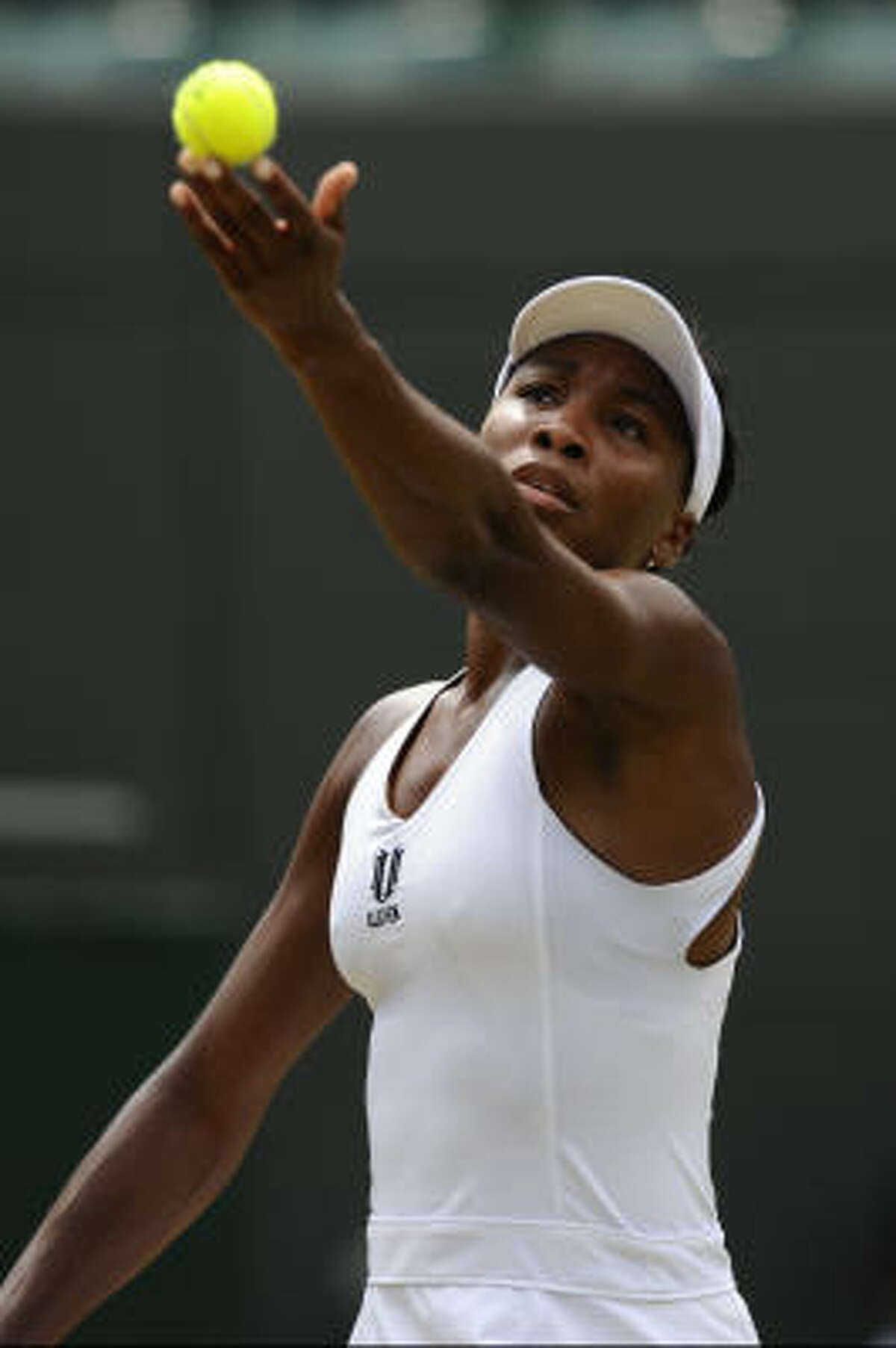 Five-time champion Venus Williams advanced to the quarterfinals at Wimbledon after Ana Ivanovic had to quit her match because of a left thigh. Williams, the No. 3 seed, was leading 6-1, 0-1 when Ivanovic had to quit.
