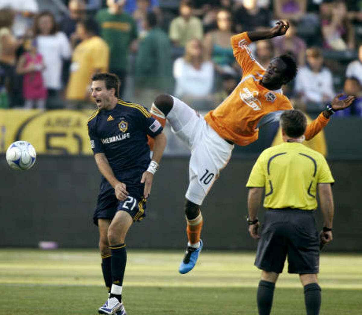 The Dynamo's Kei Kamara (10) is shielded from the ball by the Galaxy's Alan Gordon (21).