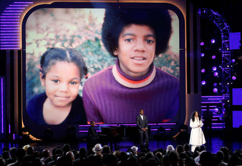 As a large screen displays an image of her and her brother Michael in earlier years, Janet Jackson thanks the BET Awards for honoring him. Photo: Kevin Winter, Getty Images