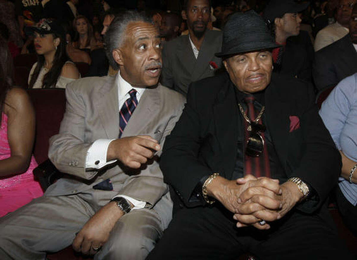 Al Sharpton, left, joined Michael Jackson's father, Joe, in the audience.