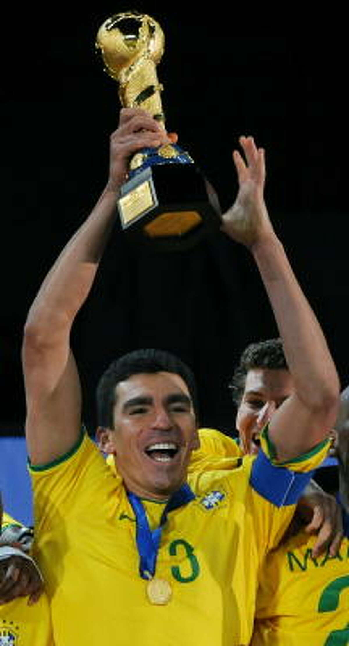 Brazilian captain Lucio celebrates with the trophy after beating the U.S.