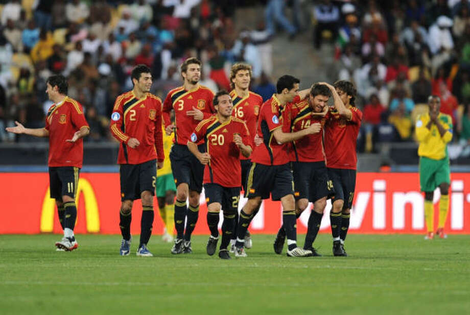 Spain 3, South Africa 2 Xabi Alonso is congratulated by teammates after scoring in extra time during the third-place match. Photo: Jasper Juinen, Getty Images