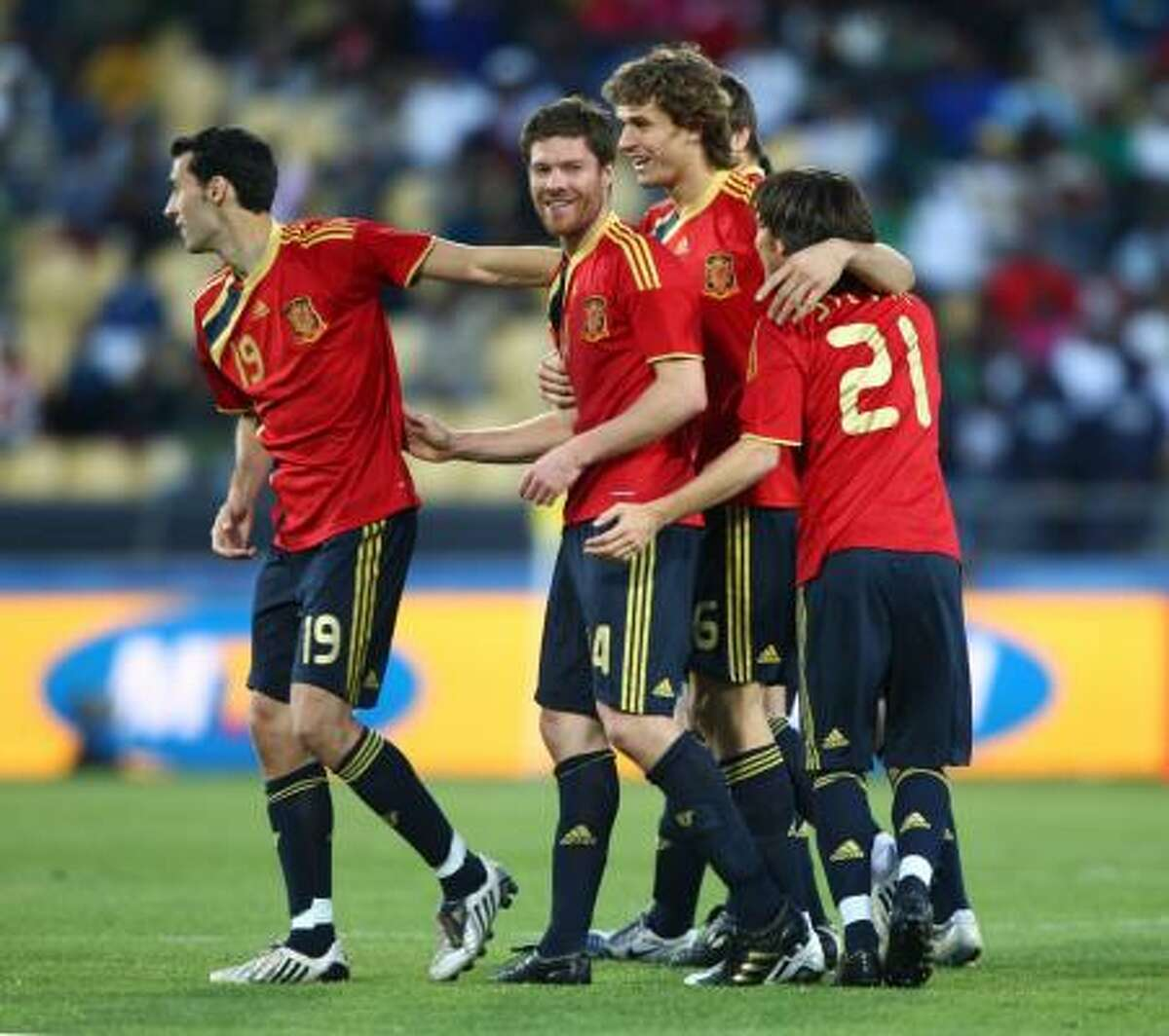 Xabi Alonso, second from left, is congratulated by teammates after scoring in extra time.