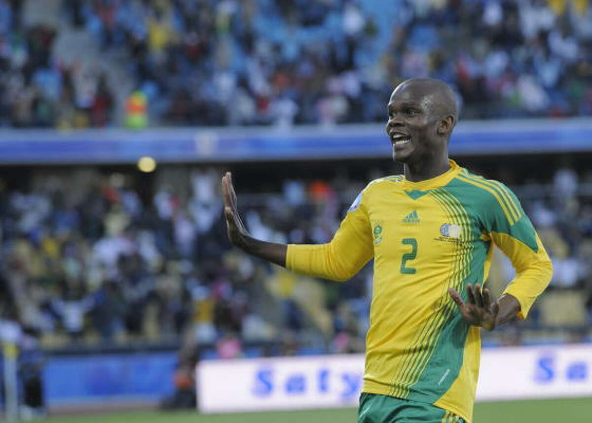 South African defender Siboniso Gaxa celebrates after teammate Katlego Mphela scored the second goal.