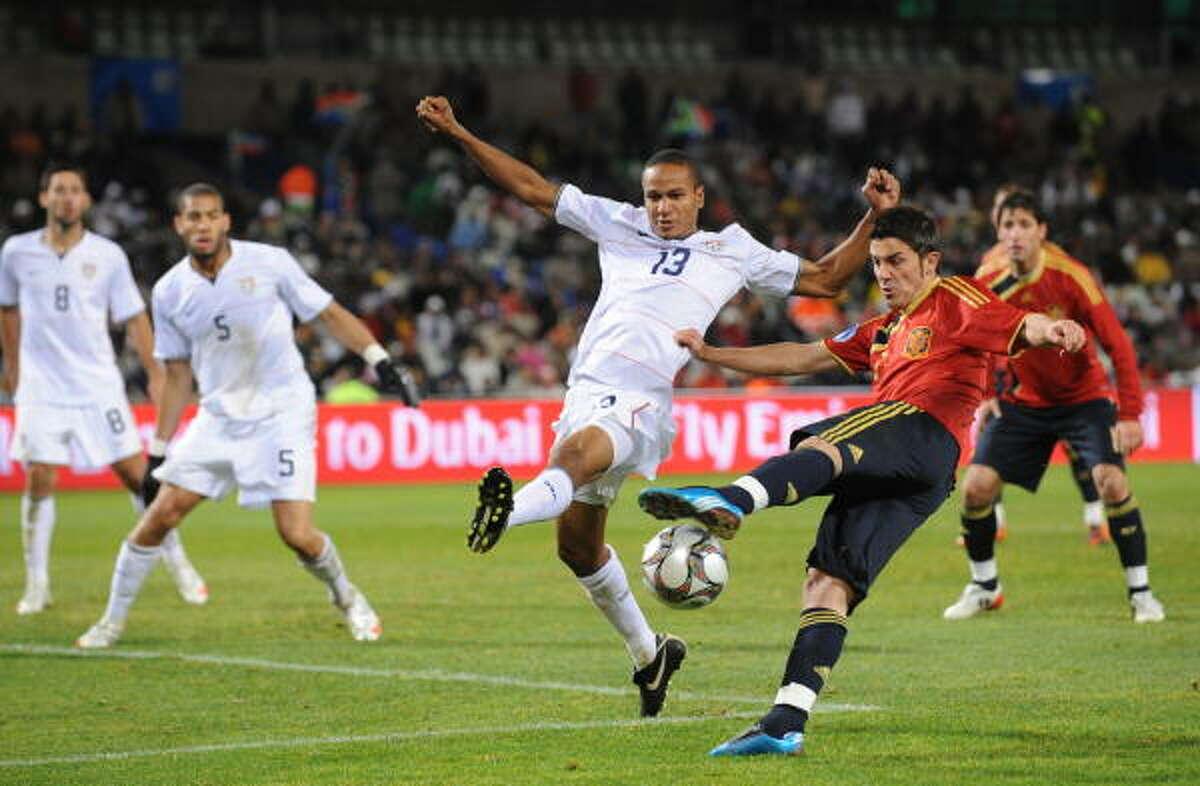United States 2, Spain 0 U.S. and Houston Dynamo midfielder Ricardo Clark (13) fights for the ball with Spanish forward David Villa.