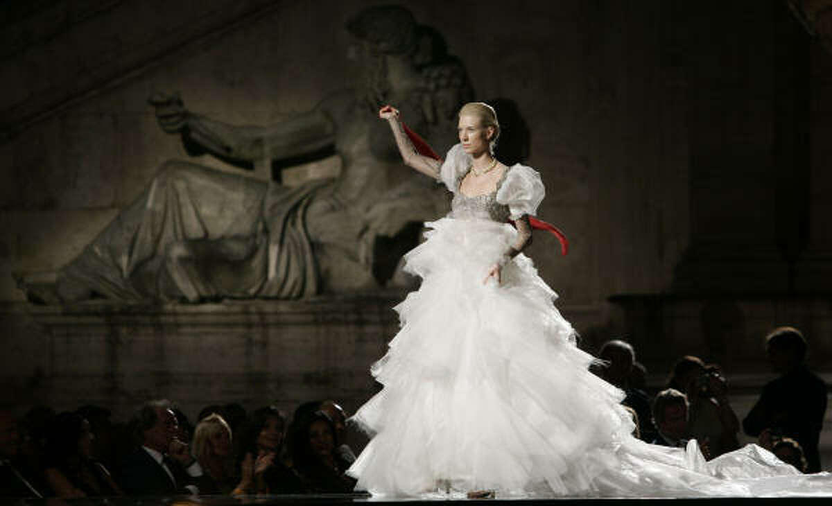 A model wears a wedding dress from the Italian fashion house Gattinoni. Get details on the latest bridal trends here.