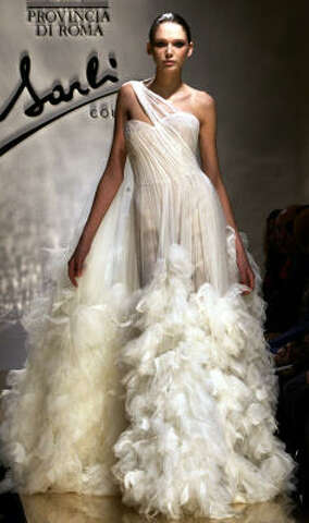 a8b5a0c31c A model wears a wedding dress creation by Italian fashion designer Fausto  Sarli for his Spring