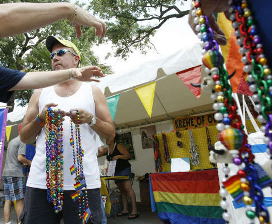 Jim Martinez sells beads at Houston's 2009 Pride festival and parade. Photo: Nick De La Torre, Chronicle